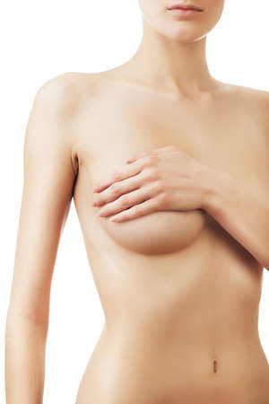 naked woman breasts: woman with hand on breast on white background
