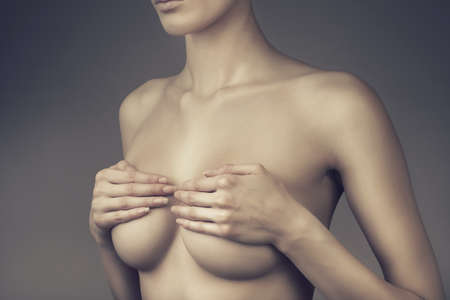 naked woman breasts: woman with closed breasts