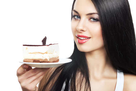 attractive woman with cake on white background photo