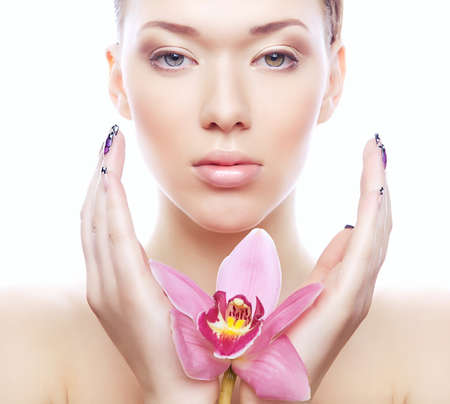 shiny woman with pink flower on white background photo