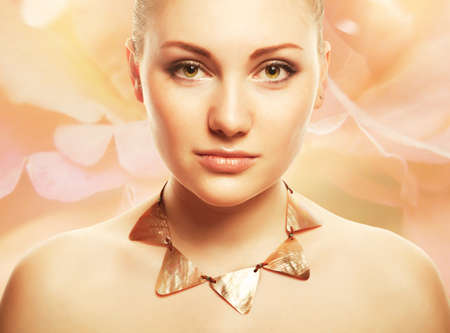 accessorize: attractive beautiful woman with accessorize on light flower background