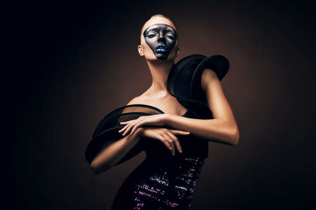 beautiful woman in black dress with mask photo