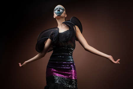 woman in black dress with mask photo