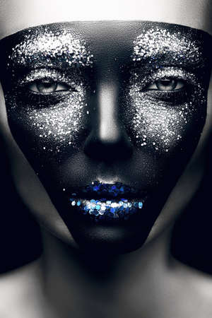 woman with black mask and blue lips