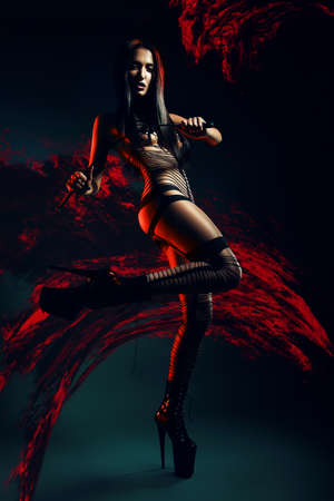 bdsm woman with whip in lava