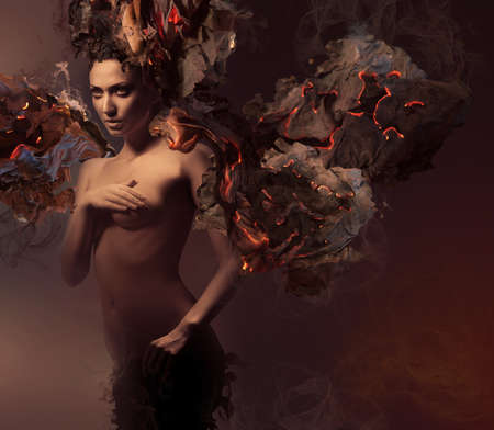 nude women: erotic nude woman in dark burning paper