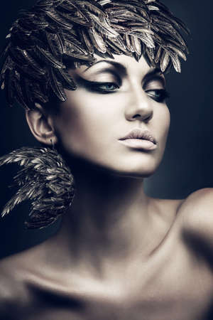 only 1 woman: portrait of brunette woman with feather hat Stock Photo