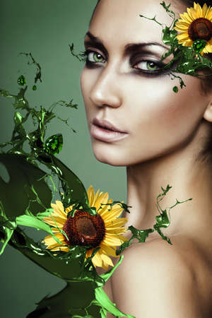 woman in green plant splash with sunflower photo