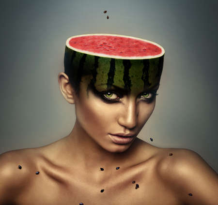 woman with watermelon head and grains photo