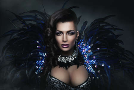 diva in accessory of diamonds and black feathers photo