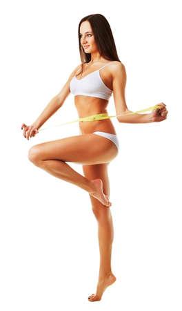 Mujer bastante saludable con la medida amarillo sobre fondo blanco Foto de archivo - 33162090
