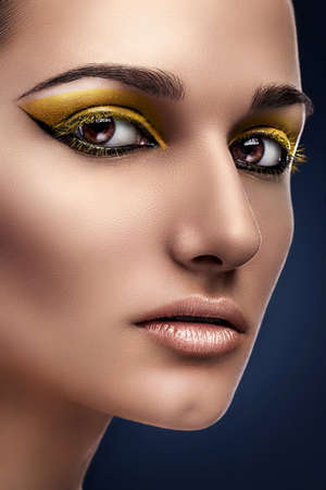 woman with yellow eyeshadows photo