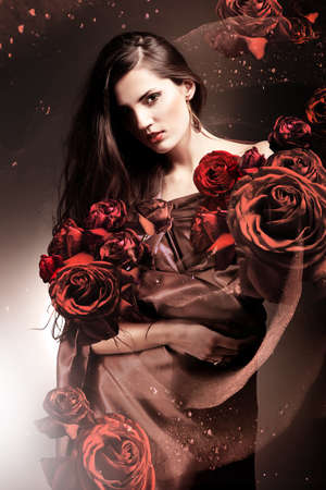 beautiful woman in chocolate fabric with chocolate roses photo
