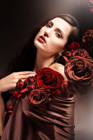 chocolate colored attractive woman with chocolate roses photo