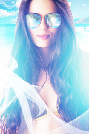 close-up portrait of woman in sunglasses on the beach