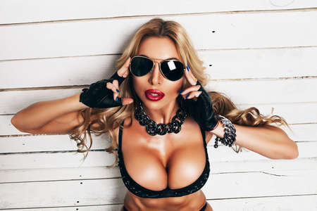 blond woman in sunglasses with big boobs Stock Photo