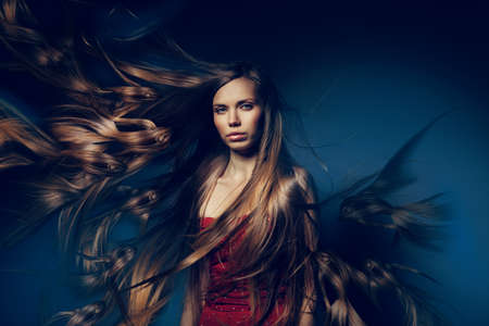 pretty woman with long fish hair photo