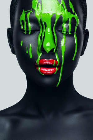 woman with flowing green paint on face