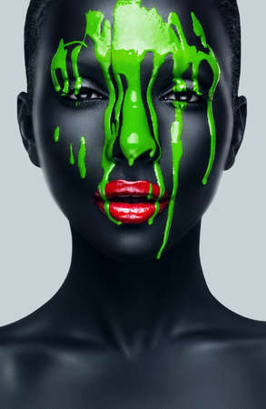 woman with red lips and black skin