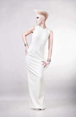 blond pretty magnificent woman in long white dress photo