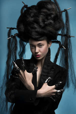 Gothic style shot of a woman with claw rings photo