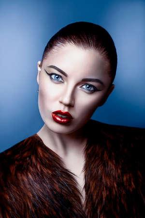 close-up portrait of a beautiful girl in a fur coat photo