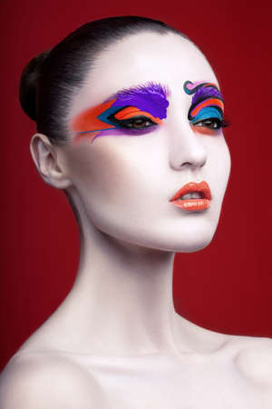 Portrait of a woman with vibrant makeup photo
