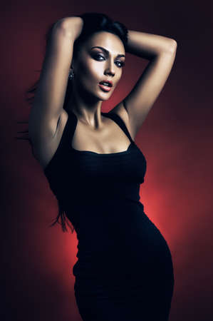 hot brunette woman in red light