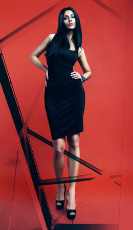 black dress: sexy woman in black dress and abstract Stock Photo
