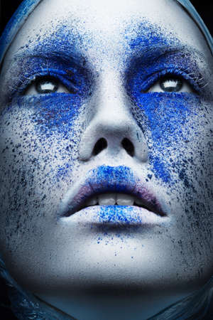 woman with creative blue make-up