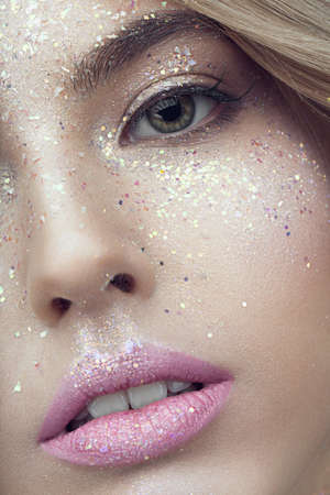 glitter makeup: Close up of woman face with glitter on face