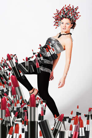 Girl with lipsticks around and on the head photo