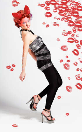 girl with red lipstick kisses and horns photo