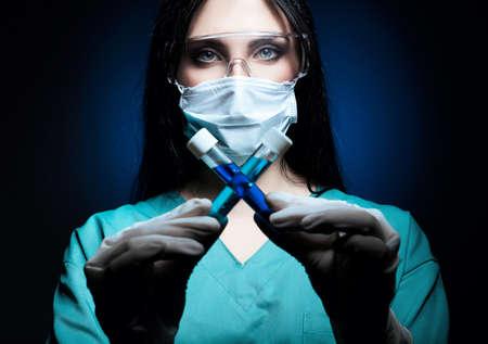scientist holding tubes in dark blue light on white background Banque d'images