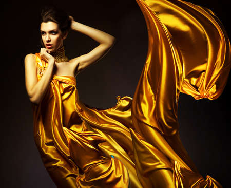 woman fashion: attractive woman in yellow fabric