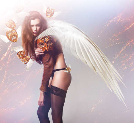 nacked: beautiful sexy woman with wings and flying masks