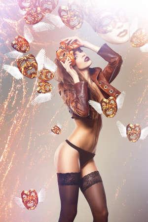 nacked: beautiful woman and flying masks Stock Photo