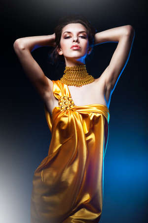 sensual attractive woman in yellow dress