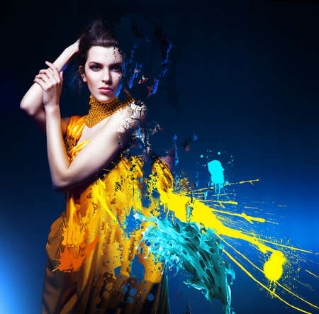 sensual sexy woman in long yellow dress and splatter photo