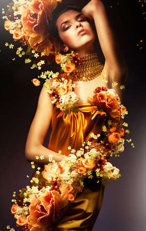sexual abstract: sensual woman in long yellow dress and flowers