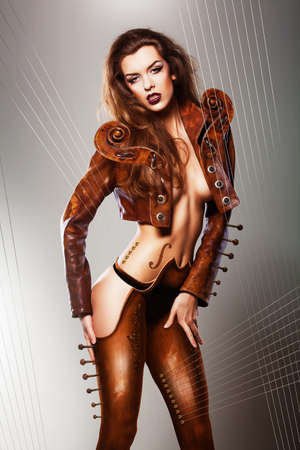 sexy music insrument woman in brown jacket photo