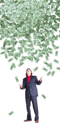 dolar: businessman catchs flying dolar banknotes on white background