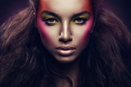 woman with magnificent hair and colorful make up