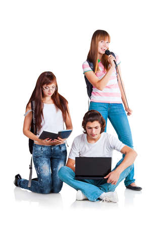 Students and their free time; a guy is looking to laptop; a girl is singing; a girl is reading and dictating to guy; on white background