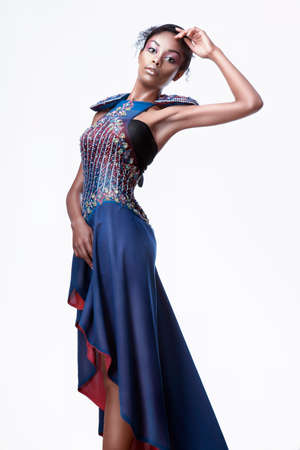 1 young woman only: Full-length photo of beautiful black woman in a blue creative dress