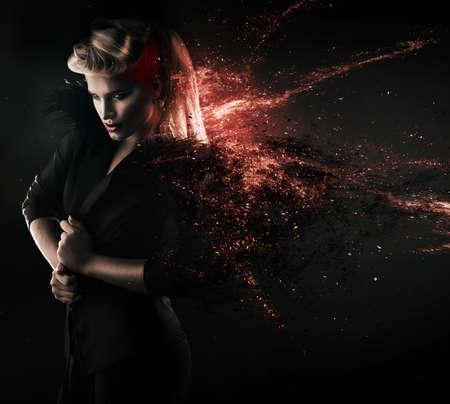 blonde woman in blazer with stars