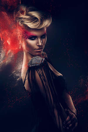blonde woman with red powder