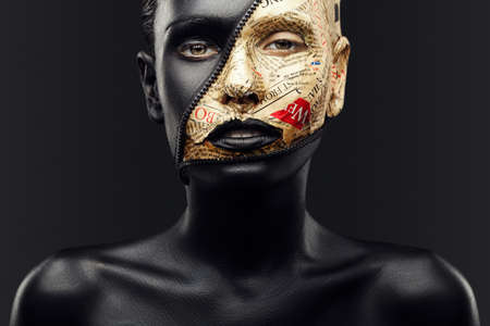 girl with black skin and make-up from the newspaper and lock zipper Banque d'images