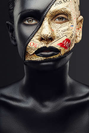 girl with black skin and make-up from the newspaper and lock fasteners Banque d'images