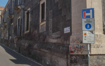 traffic sign in the corner of the street in Catania (Sicily)